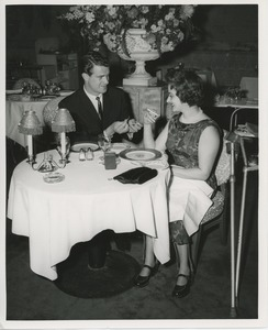 Thumbnail of Man lighting cigarette for June Trietsch Arzt at a restaurant