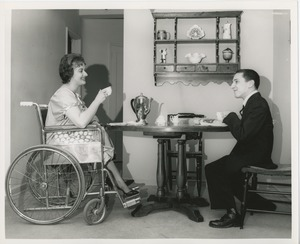Thumbnail of June Trietsch Arzt in wheelchair and unidentified man with disability having tea
