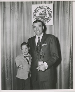 Thumbnail of Ed Furgol with an ICD tropy and young boy with phocomelia