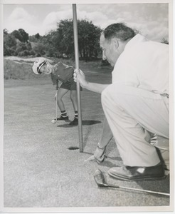 Thumbnail of Billy Bruckner posing at a golf course