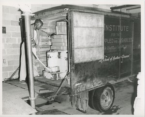 Thumbnail of Unidentified man loading boxes onto a truck