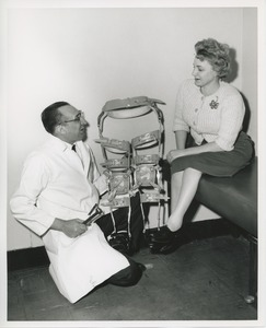Thumbnail of Doctor presenting Mrs. Frances Marsala's with a hip to foot double leg brace