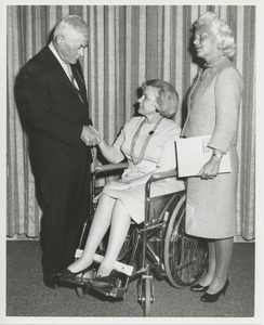 Thumbnail of Margaret Milbank Bogert with an unidentified man and a woman seated in a wheelchair