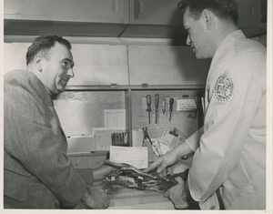 Thumbnail of A technician collaborates with a doctor on the fabrication of a leg brace