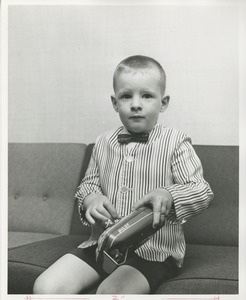 Thumbnail of A young boy uses his new prosthetic hand
