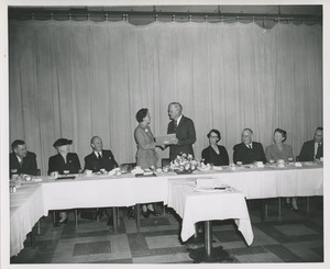 Thumbnail of Presentation of a certificate at the Institute for the Crippled and Disabled's 35th anniversary Red Cross luncheon