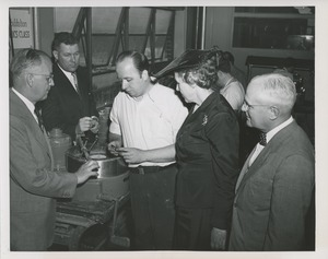 Thumbnail of Mary Switzer and a group of men observe a trainee at the Institute for the Crippled and Disabled