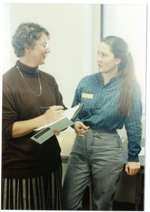 Thumbnail of Organic Farmers Associations Council meeting: two women in conversation at the conference
