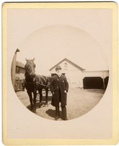 Thumbnail of Albert Henry Blanchard standing by horse and carriage