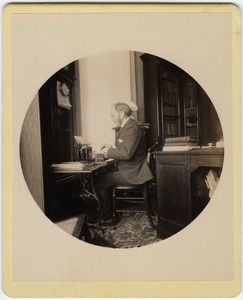 Thumbnail of C.P. Blanchard typing at his desk