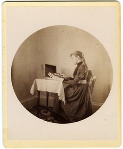 Thumbnail of Abby F. Blanchard operating a card punching machine