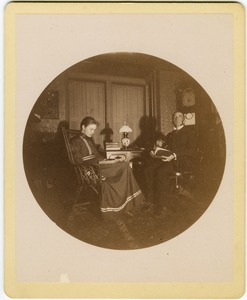 Thumbnail of Abby F. Blanchard and C. P. Blanchard, reading at a table in the parlor