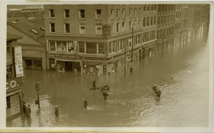 Thumbnail of Aftermath of the great Hartford Flood Flood waters on State Street (Manchester Leaf Tobacco Co. Building with          Good-Fit Uniform Co., State Pharmacy, and Fox Press)