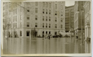 Thumbnail of Aftermath of the great Hartford Flood Flooded streets in downtown Hartford, pumping water with a steam pump (near          corner of Trumbull and Jewell Streets)