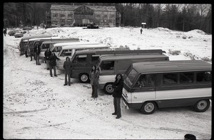 Thumbnail of Brotherhood of the Spirit Dodge van advertisements: line of commune members and             Dodge vans with commune house in background