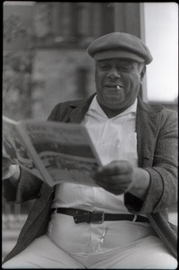 Thumbnail of Middle-aged man reading copy of Free Spirit Press