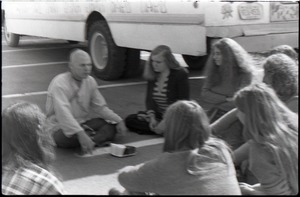 Thumbnail of Free Spirit Press crew seated outside bus with Hare Krishna devotee