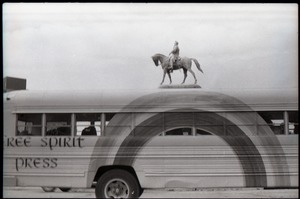 Thumbnail of Free Spirit Press bus driving past an equestrian statue