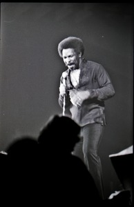 Thumbnail of Richard Nader's Rock and Roll Revival concert at the Springfield Civic Center:             Lloyd Price with microphone facing the audience