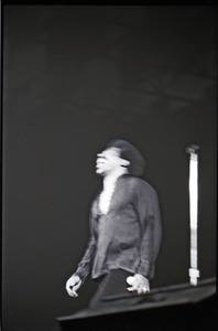 Thumbnail of Richard Nader's Rock and Roll Revival concert at the Springfield Civic Center:             Lloyd Price throwing back his head (blurry image)