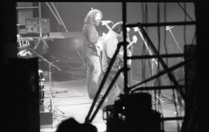 Thumbnail of Grateful Dead concert at Springfield Civic Center: shot from behind the stage of         Jerry Garcia (guitar)