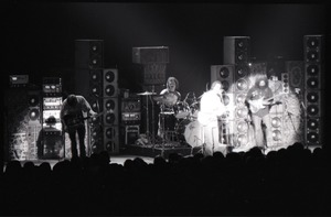 Thumbnail of Grateful Dead concert at Springfield Civic Center: band in performance in front             of a wall of speakers (spotlight on Bob Weir and Jerry Garcia)