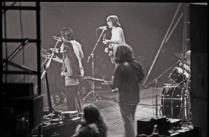 Thumbnail of Grateful Dead concert at Springfield Civic Center: band in performance, backup             singer, Bob Weir, Phil Lesh, and Jerry Garcia