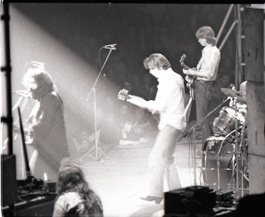 Thumbnail of Grateful Dead concert at Springfield Civic Center: band in performance: Jerry             Garcia, Bob Weir, and Phil Lesh (l. to r.)