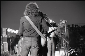 Thumbnail of Hollywood Speedway Rock Festival: unidentified band in concert: view of             guitarists from behind