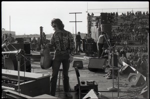 Thumbnail of Hollywood Speedway Rock Festival: unidentified acoustic guitarist on stage,             possibly with Wet Willie