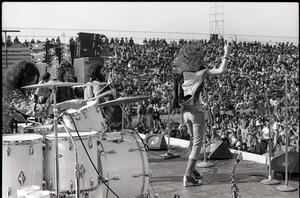 Thumbnail of Hollywood Speedway Rock Festival: Wet Willie in performance, (l. to r.) Lewis             Ross (drums), Jack Hall (bass), Rick Hirsch (guitar), and Jimmy Hall (vocals) wearing cape
