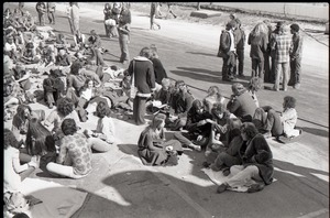 Thumbnail of Hollywood Speedway Rock Festival: crowd lying around, waiting for concert