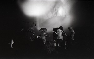 Thumbnail of Hot Tuna concert: Band in performance on stage: band with light show behind