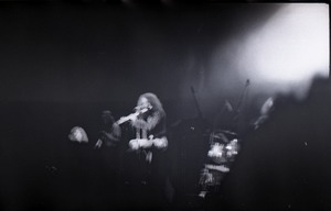 Thumbnail of Jethro Tull in concert at the Springfield Civic Center: blurry image of             Ian Anderson (on flute)