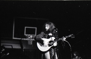 Thumbnail of Jethro Tull in concert at the Springfield Civic Center: Ian Anderson playing             acoustic guitar