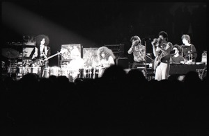 Thumbnail of Santana concert at the Springfield Civic Center: Carlos Santana (maracas) and band