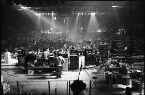 Thumbnail of Santana concert at the Springfield Civic Center: view of stage and instruments, audience lights up