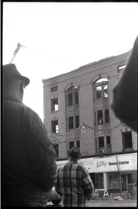 Thumbnail of Fire on Main Street, Greenfield, Mass.: crowd looking up at burned out building