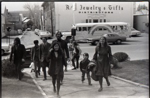 Thumbnail of Group of commune members arriving, Free Spirit Press bus parked in background