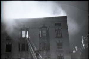 Thumbnail of Fire on Main Street, Greenfield, Mass.: ladder extended to burning building