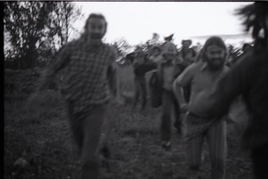 Thumbnail of Communards running toward camera (blurry)