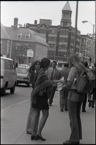 Thumbnail of Young women distributing Free Spirit Press magazine on the street