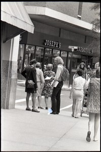 Thumbnail of Free Spirit Press crew member handing out magazine on a street corner