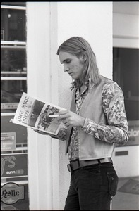 Thumbnail of Tom Frank standing on a corner, reading a copy of Free Spirit Press (vol.             1, 4)