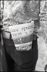 Thumbnail of Close-up of Free Spirit Press (vol. 1, 4) in Tom Frank's rear pocket