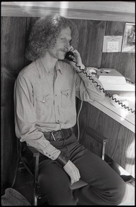 Thumbnail of Gordon Adams on the phone in the Free Spirit Press office