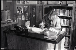 Thumbnail of Lynn Smith seated at a desk in the Free Spirit Press office