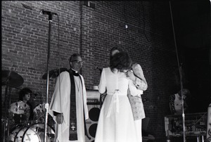 Thumbnail of Wedding of Jim and Anne Baker: kissing the bride
