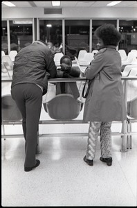 Thumbnail of Couple and child waiting at JFK airport
