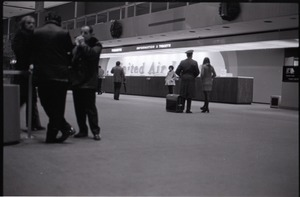Thumbnail of People milling about in front of United Airlines ticket counter at JFK airport